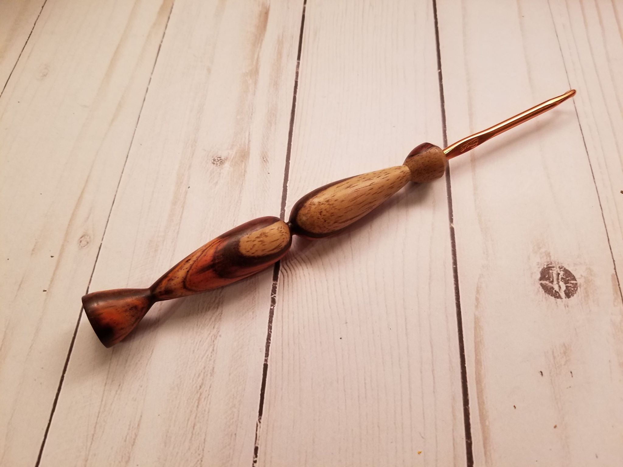 Custom hand turned crochet hook.