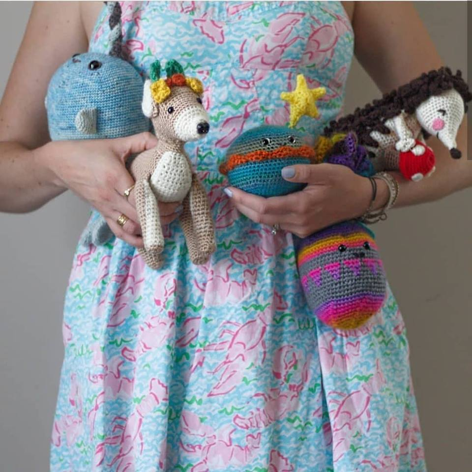 Lee Sartori with a collection of amigurumi she has designed.