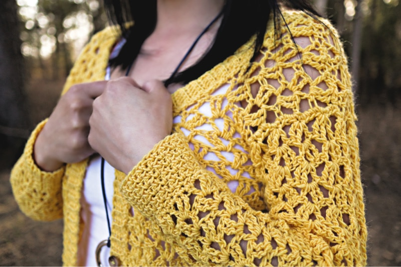 Close up photo of the sleeves on the Addy Lace Cardigan crochet pattern.