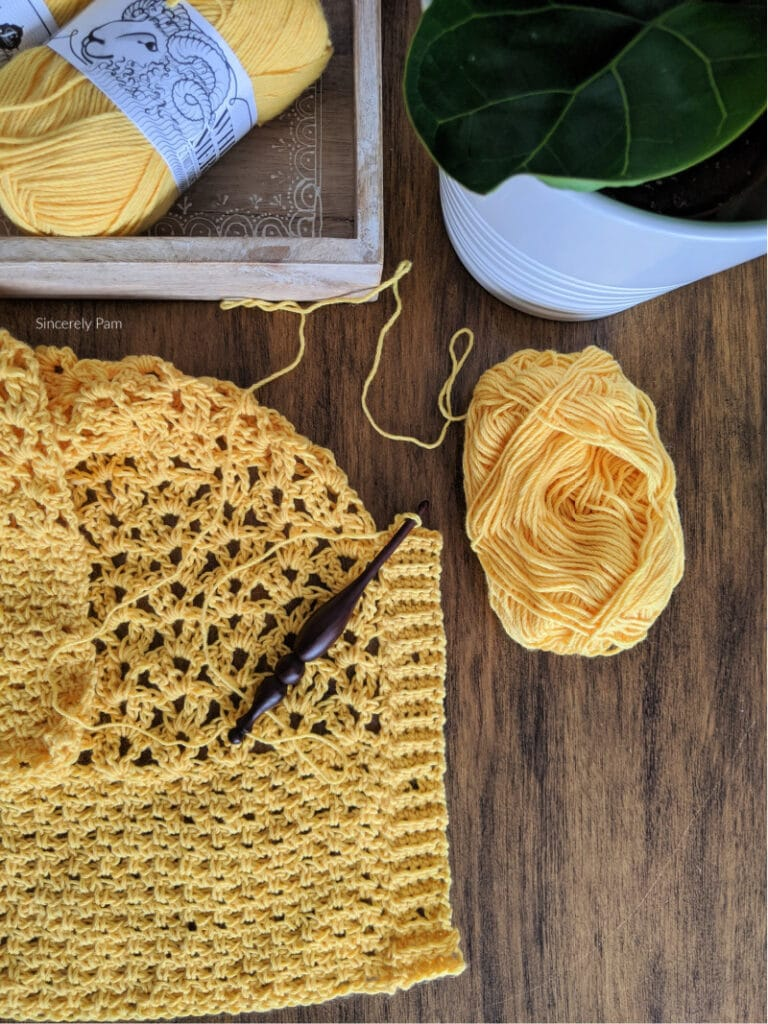 The ribbed band and button holes are being crocheted directly onto the front panel of the Addy Lace cardigan.